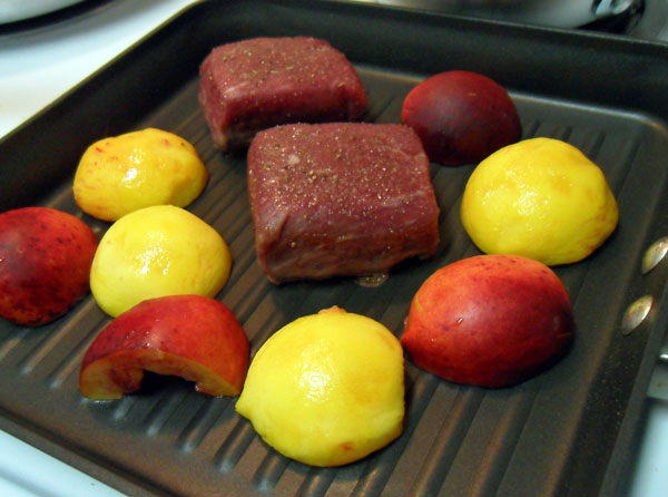 Steak and peaches in the grill pan